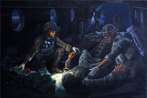 Medics treating a casualty on a Chinook during a night operation